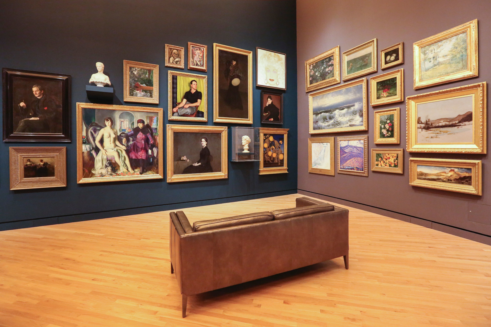 Display of several paintings in a museum