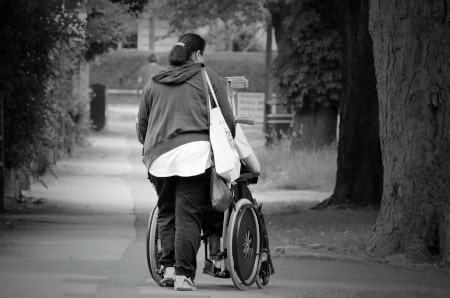 A wheelchair user and his carer